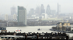 © Licensed to London News Pictures. 29/12/2012.Wet weather (today 29.12.12) in Greenwich Park,Greenwich, London. .A wet view across London from Greenwich Park with the river Thames looking high..today.Photo credit : Grant Falvey/LNP