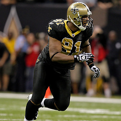 2009 November 02: New Orleans Saints defensive end Will Smith (91) rushes the quarterback against the Atlanta Falcons during a 35-27 win by the Saints over the Falcons at the Louisiana Superdome in New Orleans, Louisiana.