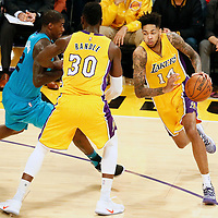 28 February 2017: Los Angeles Lakers forward Brandon Ingram (14) drives past Charlotte Hornets forward Marvin Williams (2) on a screen set by Los Angeles Lakers forward Julius Randle (30) during the Charlotte Hornets 109-104 victory over the LA Lakers, at the Staples Center, Los Angeles, California, USA.