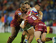 Aaron Murphy and Michael Lawrence of Huddersfield Giants tackle Tinirau Arona of Wakefield Trinity during the Betfred Super League Super 8's match at the John Smiths Stadium, Huddersfield<br /> Picture by Stephen Gaunt/Focus Images Ltd +447904 833202<br /> 31/08/2018
