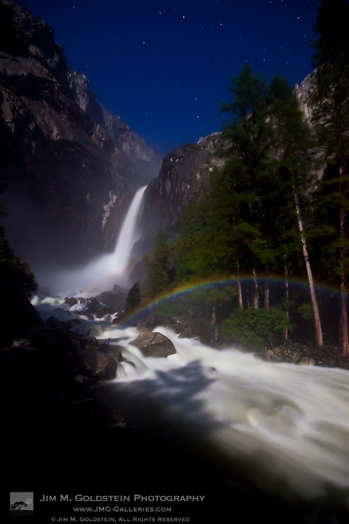 Lunar Rainbow, also known as a moonbow, appears under moonlight at  Lower Yosemite Falls - Yosemite National Park, California