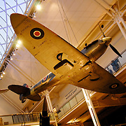 Plane hanging in the foyer of the Imperial War Museum, London. The museum features military vehicles, weapons and a photographic archive of Britains historical battles.