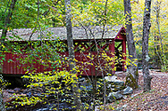 A covered bridge amid the Autumn colors at Chatfield Hollow State Park in Connecticut