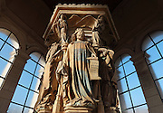 King David wearing a crown and holding a harp and psalm, from the Puits de Moise, or Well of Moses, 1395-1403, sculpted by Claus Sluter, 1340-1406, and his studio, and painted by Jean Malouel, 1365-1415, in the courtyard of the Chartreuse de Champmol, the burial site of Philippe le Hardi duc de Bourgogne, or Philip the Bold Duke of Burgundy, now the Hospital de la Chartreuse, Dijon, Burgundy, France. The sculpture was commissioned by Jean sans Peur or John the Fearless, and consists of a crucifixion scene surrounded by 6 prophets (Moses, David, Jeremiah, Zachariah, Daniel and Isaiah), with 6 weeping angels. The hexagonal building surrounding the sculpture was added in the 17th century. Picture by Manuel Cohen