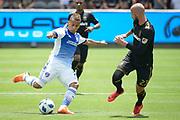 FC Dallas midfielder Michael Barrios (21) in action against Los Angeles FC defender Laurent Ciman (23) during a MLS soccer match in Los Angeles, Saturday, May 5, 2018. (Eddie Ruvalcaba/Image of Sport)
