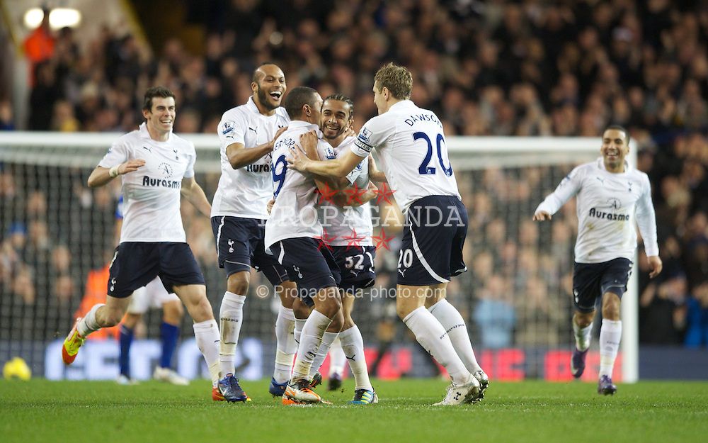 LONDON, ENGLAND - Wednesday, January 11, 2012: Tottenham Hotspur's Benoit Assou-Ekotto is congratulated by his team-mates after scoring his side's second goal during the Premiership match at White Hart Lane. (Pic by Chris Brunskill/Propaganda)