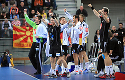 Players of Germany celebrate during 21st Men's World Handball Championship preliminary Group C match between FYR Macedonia and Germany, on January 21, 2009, in Arena Varazdin, Varazdin, Croatia. (Photo by Vid Ponikvar / Sportida)