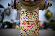CHARLESTON, SC. - JUNE, 30, 2015: Visitors to Emanuel A.M.E Church have started writing words of hope and grief on a fire hydrant and crepe myrtle trees at the memorial in front of the church,  Tuesday June 30, 2015 in Charleston, S.C. CREDIT: Stephen B. Morton for The New York Times