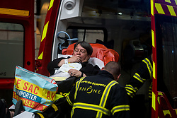 May 24, 2019, Lyon, France: Emergency workers stretcher a woman to a waiting ambulance after a suspected package bomb blast along a pedestrian street in the heart of Lyon, southeast France, the local prosecutors' office said. More than a dozen people were injured in the explosion. (Credit Image: © Nicolas Liponne/NurPhoto via ZUMA Press)