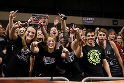 Wheeling Central student section celebrates their victory at the end of the game.
