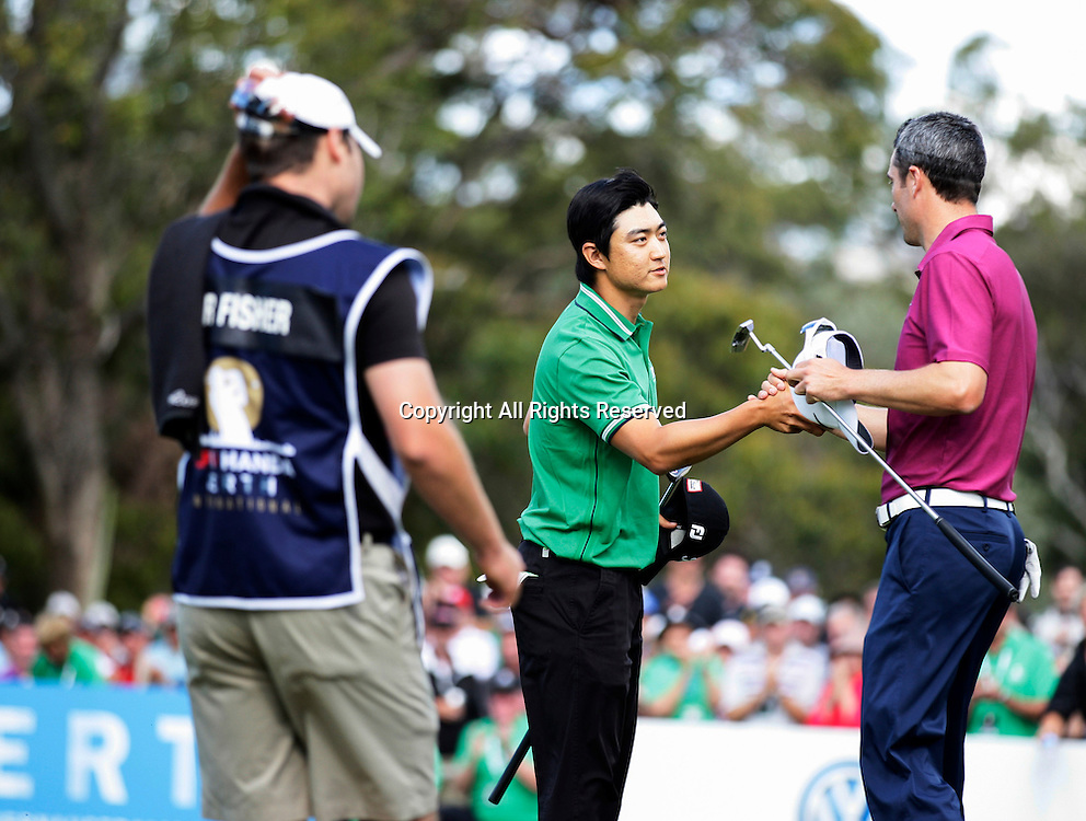 20.10.2013 Perth, Australia. Jin Jeong (KOR) shakes hands with Ross Fisher (ENG) after beating him in a play off for the title during the final day of the ISPS Handa Perth International Golf Championship from the Lake Karrinyup Country Club.