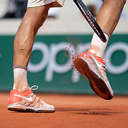 PARIS, FRANCE June 04. Roger Federer of Switzerland knocks the clay off his tennis shoes during his match against Stan Wawrinka of Switzerland on Court Suzanne Lenglen during the Men's Singles Quarter Final match at the 2019 French Open Tennis Tournament at Roland Garros on June 4th 2019 in Paris, France. (Photo by Tim Clayton/Corbis via Getty Images)