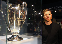 14.10.2014, Allianz Arena, M&uuml;nchen, GER, 1. FBL, FC Bayern Muenchen, Xabi Alonso, im Bild Xabi Alonso (FC Bayern M&uuml;nchen) neben dem Champions League Pokal // FC Bayern Munich player Xabi Alonso visits the FC Bayern Erlebniswelt Museum at the Allianz Arena in M&uuml;nchen, Germany on 2014/10/14. EXPA Pictures &copy; 2014, PhotoCredit: EXPA/ Eibner-Pressefoto/ FCB/Getty Pool<br /> <br /> *****ATTENTION - OUT of GER*****