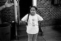 Dehab Fauz, (10) stands out in front of her home that was completely destroyed after Hurricane Katrina made land fall over a month ago Tuesday, 4 October 2005 New Orleans Louisiana.  Dehab and her parents returned to their home and business to find out their along with the damage from the storm their home and small business, a grocery store was completely looted and destroyed.       photo by Darren Hauck