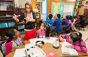 Raquel Sosa-Gonzalez teaches reading to 8th graders at Las Americas Middle School, May 7, 2013.
