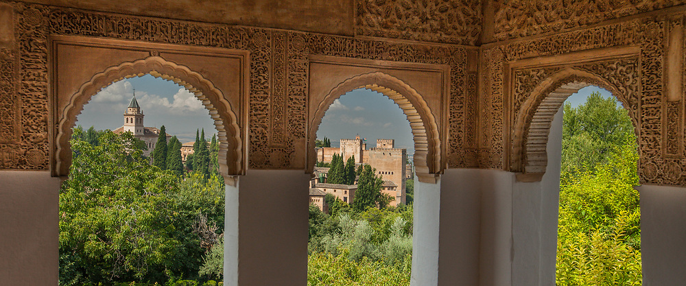 Alhambra Palace archways with view of town, Spain
