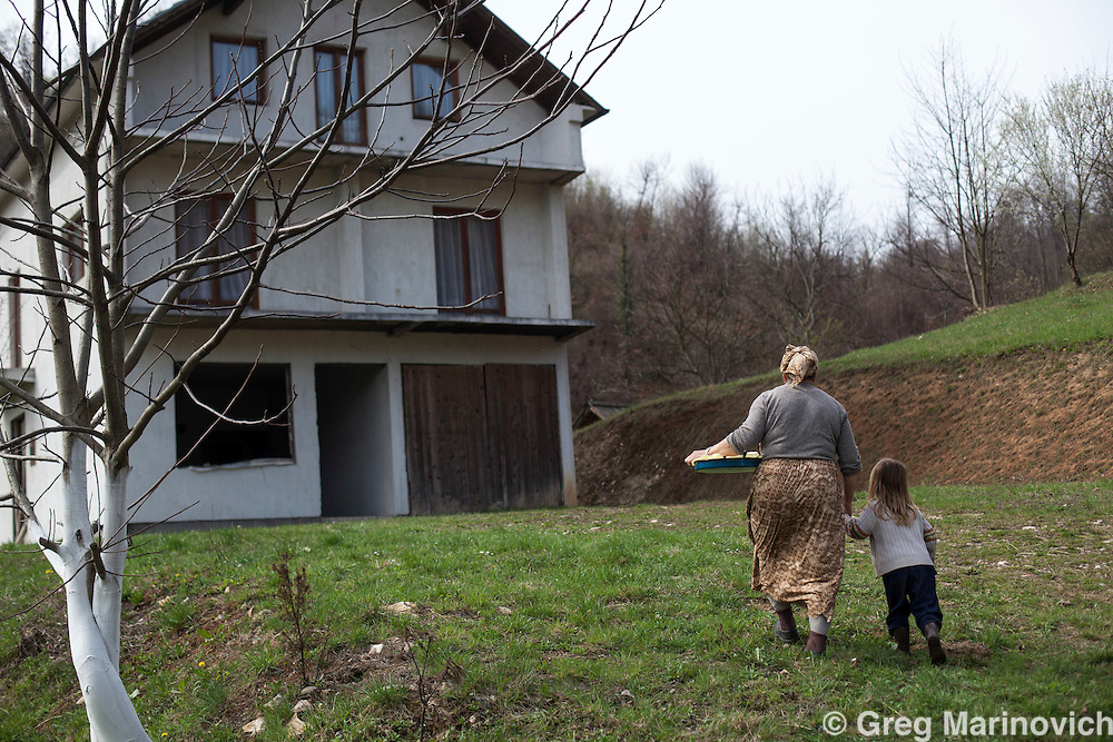 Bosnia, April 4, 2012. A Bosniak or Bosnian Moslem family who have returned to the home they were forced out of during the 1992-1996 Bosnian war. The house has been mostly rebuilt. Greg Marinovich