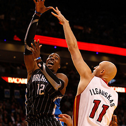 March 3, 2011; Miami, FL, USA; Orlando Magic center Dwight Howard (12) shoots over Miami Heat center Zydrunas Ilgauskas (11) during the first quarter at the American Airlines Arena.    Mandatory Credit: Derick E. Hingle