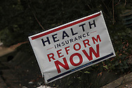 A health care reform sign in front of a home in Fairfax County Virginia.  Photo by Dennis Brack