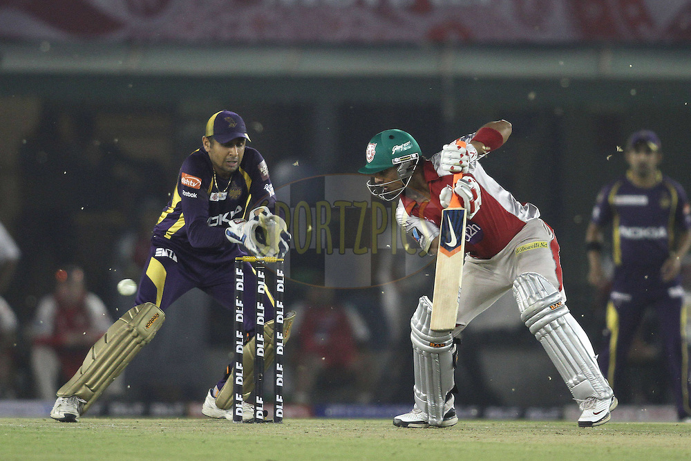 Mandeep Singh of the Kings XI Punjab cuts a delivery behind square during match 22 of the the Indian Premier League ( IPL) 2012  between The Kings X1 Punjab and The Kolkata Knightriders held at the Punjab Cricket Association Stadium, Mohali on the 18th April 2012..Photo by Shaun Roy/IPL/SPORTZPICS.