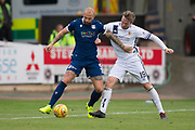 14th September 2019; Dens Park, Dundee, Scotland; Scottish Championship, Dundee Football Club versus Alloa Athletic; Jordon Forster of Dundee challenges for the ball with Robert Thomson of Alloa Athletic