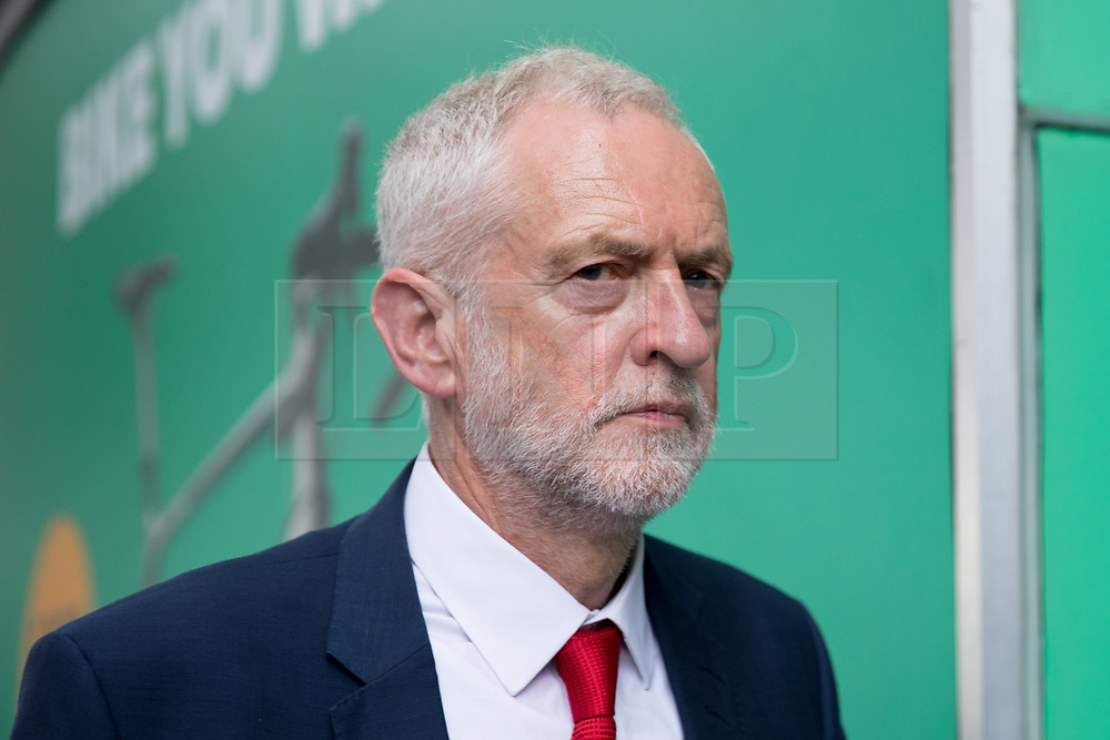 © Licensed to London News Pictures. 03/06/2018. London, UK. Leader of the Labour Party Jeremy Corbyn leaves after laying flowers to mark one year since the London Bridge and Borough Market terror attacks. A series of events have taken place throughout the day, including a service of commemoration at Southwark Cathedral, the planting of an olive tree in the Cathedral grounds, a minute's silence at 4:30pm and the laying of flowers.  Photo credit : Tom Nicholson/LNP