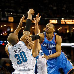 January 24,  2011; New Orleans, LA, USA; New Orleans Hornets power forward David West (30) blocks a shots by Oklahoma City Thunder point guard Russell Westbrook (0) during the third quarter at the New Orleans Arena. The Hornets defeated the Thunder 91-89. Mandatory Credit: Derick E. Hingle