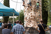 kids learning rock climbing at a rural outdoors day fair