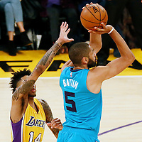28 February 2017: Charlotte Hornets guard Nicolas Batum (5) takes a jump shot past Los Angeles Lakers forward Brandon Ingram (14) during the Charlotte Hornets 109-104 victory over the LA Lakers, at the Staples Center, Los Angeles, California, USA.