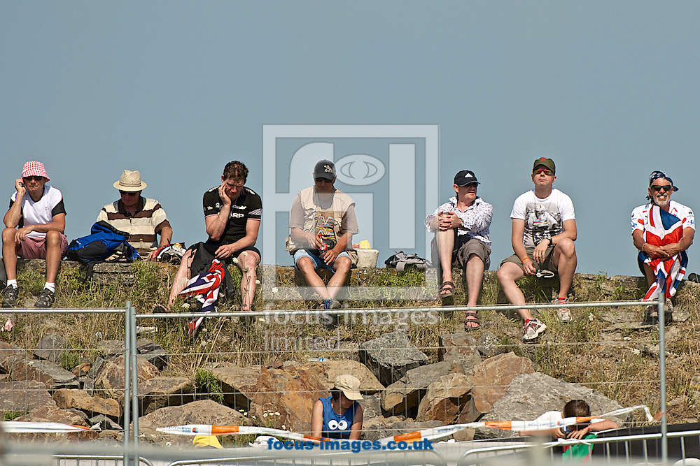 Picture by Ian Wadkins/Focus Images Ltd +44 7877 568959<br /> 10/07/2013<br /> British fans wait patiently to cheer on race leader and yellow jersey holder Chris Froome during stage 11 of the 2013 Tour de France in Mont Saint Michel, France.