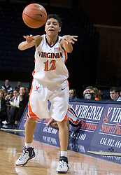 Virginia Cavaliers Guard Britnee Millner (12) passes the ball in action against the North Florida Lady Ospreys Women's Basketball Team.  The University of Virginia Cavaliers defeated the North Florida Lady Ospreys Women's Basketball Team 90-57 at the John Paul Jones Arena in Charlottesville, VA on February 6, 2007.