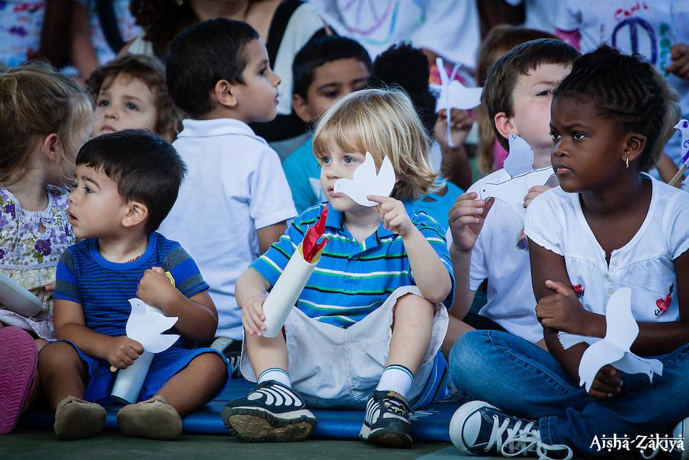 (L-R) Niccolo Defelice (toddler), Charles Gerritsen(toddler), and Sinaii Williams (1st grader).  2012 Peace Day Celebration.  VI Montessori School and International Academy.  21 September 2012.  © Aisha-Zakiya Boyd