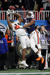 Auburn Tigers defensive back Traivon Leonard (21) breaks up a pass intended for UCF Knights quarterback Sean Pratt (19) during the 2018 Chick-fil-A Peach Bowl NCAA football game on Monday, January 1, 2018 in Atlanta. (Jason Parkhurst / Abell Images for the Chick-fil-A Peach Bowl)