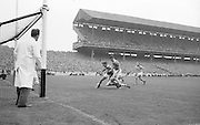 Roscommon center forward C Mahon figits his way through Kerry's S Sheehy during the All Ireland Senior Gaelic Football Championship Final Kerry v Roscommon in Croke Park on the 23rd September 1962. Kerry 1-12 Roscommon 1-6.