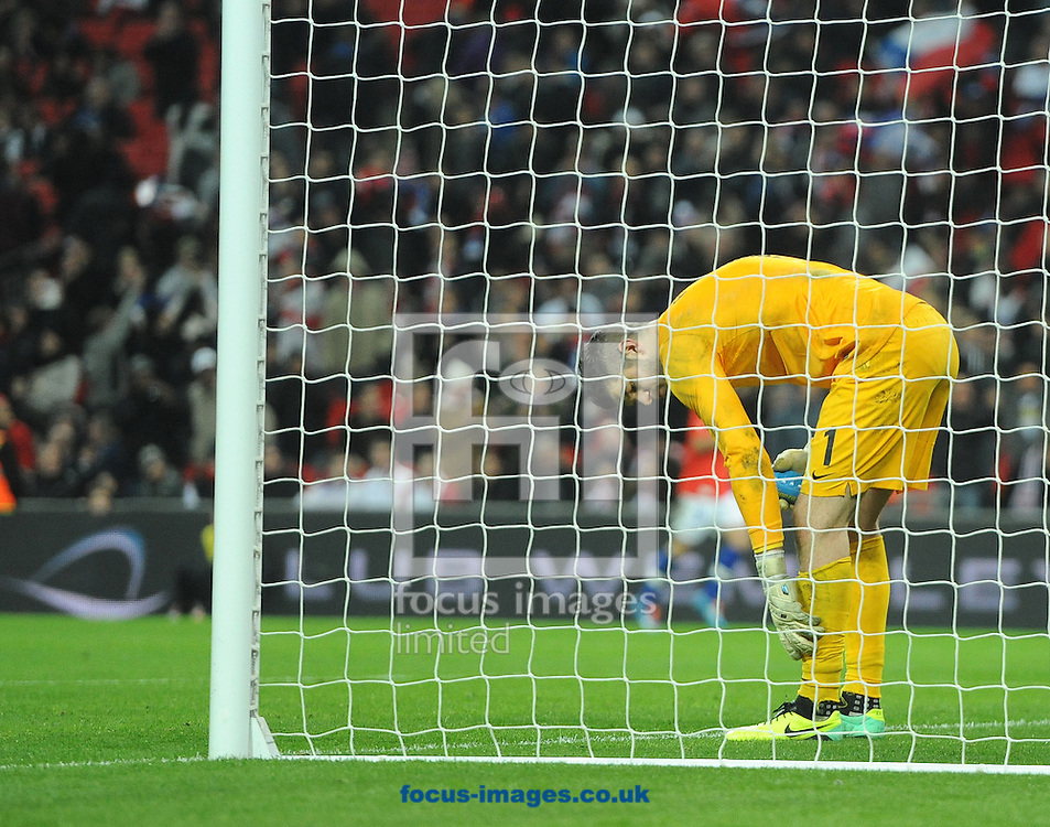 Picture by Daniel Hambury/Focus Images Ltd +44 7813 022858<br /> 15/11/2013<br /> Fraser Forster of England reacts after conceding the second goal during the Friendly match at Wembley Stadium, London.