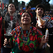 Araceli Jaime cries as a totem pole is erected during a ceremony at the Seattle Center on Sunday February 26, 2012 in Seattle. A 33-foot tall totem pole was erected Sunday in honor of slain Native American woodcarver John T. Williams. Williams was shot and killed by a Seattle Police officer in 2010. The shooting was later ruled unjustified.  (Joshua Trujillo, seattlepi.com)