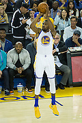 Golden State Warriors forward Kevin Durant (35) shoots a three pointer against the Oklahoma City Thunder at Oracle Arena in Oakland, Calif., on November 3, 2016. (Stan Olszewski/Special to S.F. Examiner)