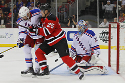 Sep 16, 2013; Newark, NJ, USA; New York Rangers goalie Cam Talbot (33) makes a save through a screen by New Jersey Devils center Rostislav Olesz (25) during the second period at Prudential Center.