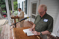 Andy Mullins (right) waits his turn as Oxford Mayor Pat Patterson reads The Reivers, written by Nobel Prize winning author William Faulkner, at the late writer's home of Rowan Oak in Oxford, Miss. on Friday, July 6, 2012. Faulkner died 50 years ago on July 6, 1962. Over 100 people are reading from the book to commemorate the occasion.