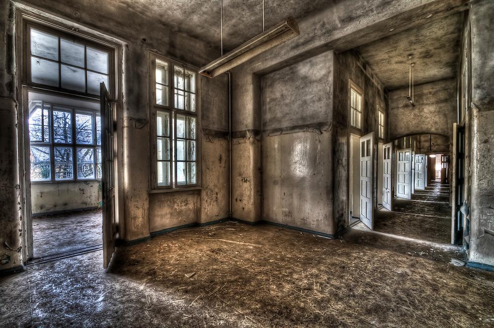 Abandoned lunatic asylum north of Berlin, Germany. Empty room with corridor.