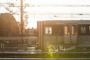 A Washington DC metro train at sunrise on an outside track.