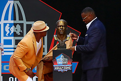 August 4, 2018 - Canton, OH, U.S. - CANTON, OH - AUGUST 04:  Brian Dawkins and Troy Vincent unveil his Bust during the 2018 Hall of Fame Enshrinement Ceremony on August 4, 2018 at the Tom Benson Hall of Fame Stadium in Canton, Ohio  (Photo by Rich Graessle/Icon Sportswire) (Credit Image: © Rich Graessle/Icon SMI via ZUMA Press)