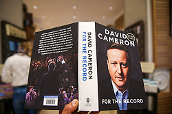 "© Licensed to London News Pictures. 19/09/2019. London, UK. A tourist from Germany views a copy of ""For The Record"" - the autobiography of Britain's former Prime Minister David Cameron on display in Waterstones book store in central London. Since his resignation in 2016, David Cameron has remained all-but silent on his time in office. In For the Record he finally breaks that silence. Photo credit: Dinendra Haria/LNP"