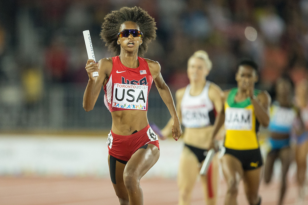 Kendall Baisden of the United States runs the final leg of the American 4x400 metre relay team to win the gold medal at the 2015 Pan American Games at CIBC Athletics Stadium in Toronto, Canada, July 25,  2015.  AFP PHOTO/GEOFF ROBINS