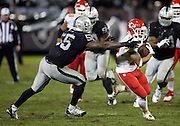 Kansas City Chiefs wide receiver Albert Wilson (12) tries to elude a tackle attempt by Oakland Raiders outside linebacker Sio Moore (55) as he catches a 23 yard pass and run to the Raiders 14 yard line in the fourth quarter during the NFL week 12 regular season football game against the Oakland Raiders on Thursday, Nov. 20, 2014 in Oakland, Calif. The Raiders won their first game of the season 24-20. ©Paul Anthony Spinelli