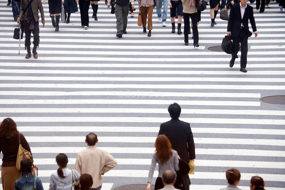 people crossing the Hachiko square zebra crossing at Shibuya station in Tokyo Japan