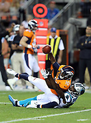 Denver Broncos wide receiver Emmanuel Sanders (10) gets tackled by Carolina Panthers cornerback James Bradberry (24) as Sanders catches a late third quarter pass good for a 6 yard gain to the Carolina Panthers 25 yard line during the 2016 NFL week 1 regular season football game against the Carolina Panthers on Thursday, Sept. 8, 2016 in Denver. The Broncos won the game 21-20. (©Paul Anthony Spinelli)