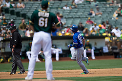OAKLAND, CA - JULY 23:  Josh Donaldson #20 of the Toronto Blue Jays rounds the bases after hitting a home run off of Dan Otero #61 of the Oakland Athletics during the fifth inning at O.co Coliseum on July 23, 2015 in Oakland, California. The Toronto Blue Jays defeated the Oakland Athletics 5-2. (Photo by Jason O. Watson/Getty Images) *** Local Caption *** Josh Donaldson; Dan Otero