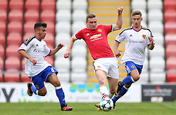 (left-right) Basel's Alessandro Stabile, Manchester United's Ethan Hamilton and Basel's Daniele Vesco battle for the ball
