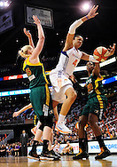 Sep 17 2011; Phoenix, AZ, USA; Phoenix Mercury  forward Candice Dupree (4) attempts to puts up a shot against the Seattle Storm forward .Lauren Jackson (15) and forward Camille Little (20) during the first half at the US Airways Center.  The Mercury defeated the Storm 92 - 83. Mandatory Credit: Jennifer Stewart-US PRESSWIRE